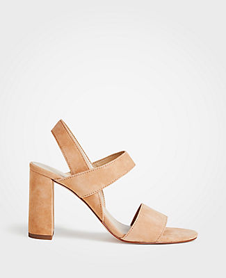 Crafted with a modern block heel, our rich suede sandals elevate any ensemble. Open toe. Padded footbed for complete comfort. Covered 3 1/2\\\