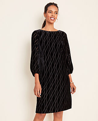 In a sheerly gorgeous geo pattern, this plush velvet shift dress dazzles - from every angle. Boatneck. 3/4 sleeves with elasticized cuffs. Hidden back zipper with hook-and-eye closure. Lined body.