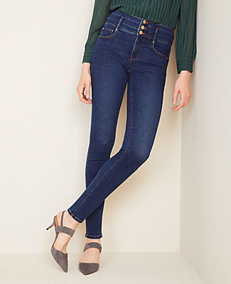 Designed with new pockets that smooth, flatter and hold your shape. Here\\\'s the skinny: your favorite jeans just got a major upgrade. Performance stretch denim sculpts, shapes and supports all day long. Front zip with button closure. Belt loops. Classic five-pocket styling. Ann Taylor Petite Sculpting Pocket High Rise Skinny Jeans in Classic Indigo Wash