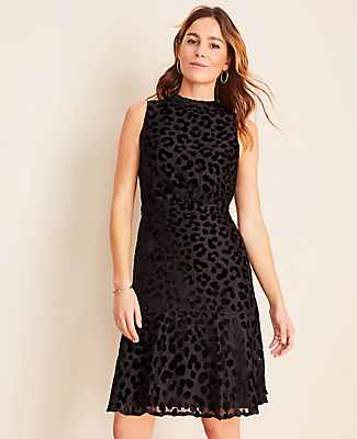 Spotted in plush velvet for a touch of animal intrigue, our cheetah-inspired sheath dress is wildly flattering. Mock neck. Sleeveless. Inset waistband. Flounce hem. Hidden back zipper with hook-and-eye closure. Lined.