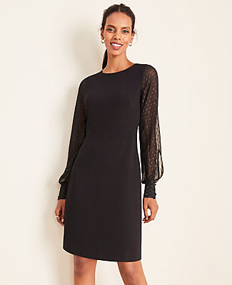 Finished with sheer and shimmery clip sleeves, this flattering shift is AM to PM perfect. Jewel neck. Long sleeves with button cuffs. Hidden back zipper with hook-and-eye closure. Lined body.
