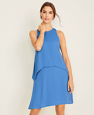 Our flowy overlay shift dress creates a stylish layered effect that works wonders - anywhere you wear it. Jewel neck. Sleeveless. Bodice side slits. Back keyhole with hook-and-eye closure. Lined.