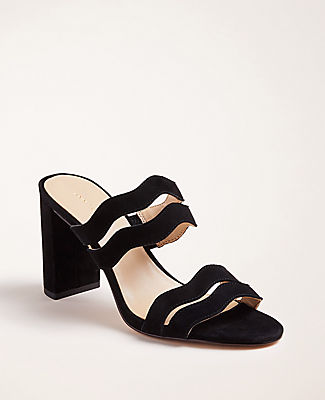 Make waves with these block heel sandals, beautifully contoured in rich suede. Open toe. Padded footbed for complete comfort. Covered 3 1/4\\\
