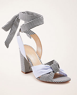 Cinched with a feminine top knot, our polished patent gingham sandals check off every box. Padded footbed for complete comfort. 3 1/4\