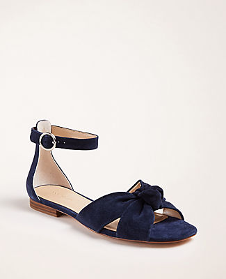 Cinched with a feminine top knot, our rich suede sandals ground your look for the season. Open toe. Adjustable buckle at side ankle for secure fit. Padded footbed for complete comfort. 1/2\
