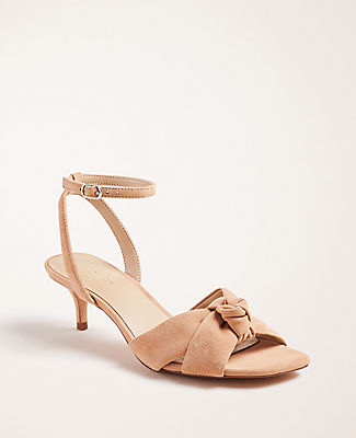 Add a feminine twist to your favorite ensemble with these rich suede sandals, crafted in a strappy slingback silhouette. Open toe. Adjustable buckle at side ankle for secure fit. Padded footbed for complete comfort. Covered 2\