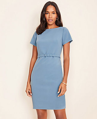 In a flattering stretch fabric, our sleek belted dress takes you from A.M. presentation to P.M. destination. Boatneck. Short sleeves. Self buckle belt. Hidden back zipper with hook-and-eye closure. Back vent. Lined body.