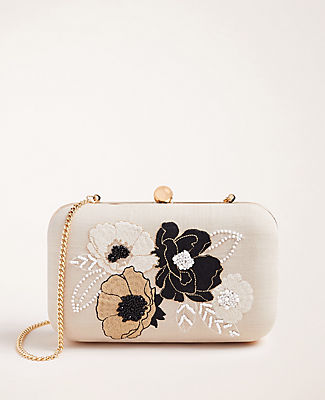 Accented with gorgeously glossy beads and embroidered florals, this polished clutch holds all of your have-to-haves. Snap top closure. Chain strap. 8\