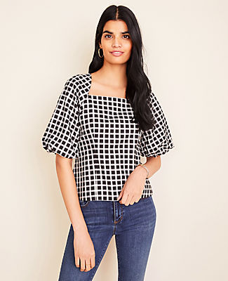 Square up the season with this puff sleeve top, done in timeless plaid. Square neck. Short sleeves with elasticized cuffs. Hidden side zipper. Lined sleeves.