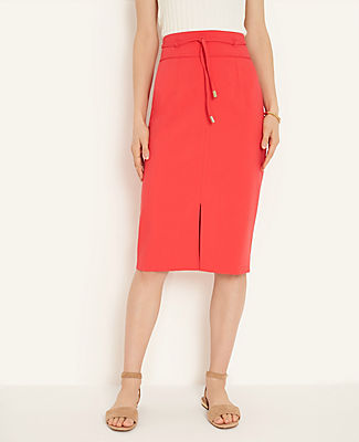 A corded waist tie puts a flattering twist on this high-waisted pencil skirt, finished with an alluring front slit. Self tie belt. Front slit. Hidden back zipper with hook-and-eye closure. Lined.