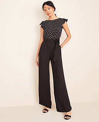 Topped with airy flutter sleeves, our polka dot belted jumpsuit is always spot-on. Boatneck. Flutter sleeves. Self tie belt. Vertical on-seam pockets. Back zipper with hook-and-eye closure. Lined bodice.