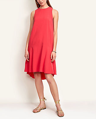 Perfect from day to night, our flattering shift dress takes a twirl with a pretty flounce hem. Jewel neck. Sleeveless. Back slit with button closure. Lined. Ann Taylor Flounce Shift Dress