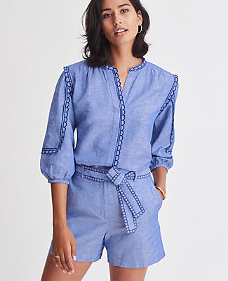 A true-blue summer staple, our linen cotton chambray popover is scallop trimmed for an extra pretty edge. Split neck. 3/4 sleeves with shirred sleeve caps. Back yoke. Shirttail hem. Ann Taylor Chambray Scalloped Popover Top