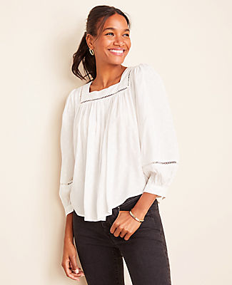 Square up the season with this beautifully framed top, enhanced with lace trim and a breezy silhouette. Square neck. Long sleeves with shirred sleeve caps and button cuffs. Shirred front and back neck frame. Shirttail hem. Ann Taylor Petite Lace Trim Balloon Sleeve Top