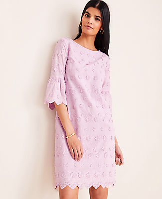Embellished with petaled florals, our embroidered shift dress weaves a romantic thread into your wardrobe. Jewel neck. 3/4 sleeves. Hidden back zipper with hook-and-eye closure. Lined body.