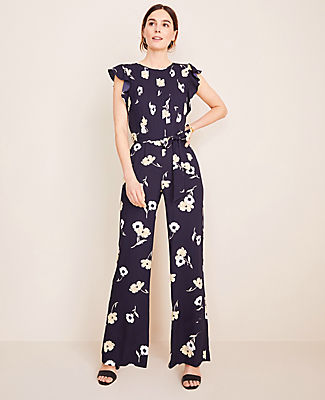 Beautifully bloomed, our flutter sleeve jumpsuit is the perfect one-and-done ensemble. Jewel neck. Flutter sleeves. Self tie belt. Front pleats. Back keyhole with hook-and-eye closure. Hidden back zipper.