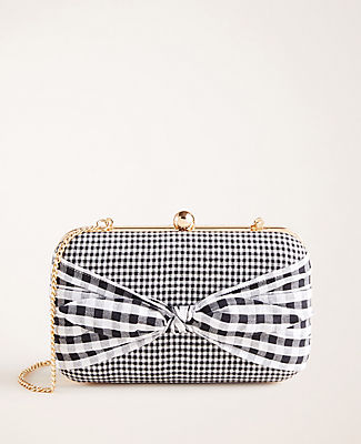 Smartly checked in pretty gingham, this bow-tied clutch holds all of your have-to-haves. Snap top closure. Chain strap. 8\