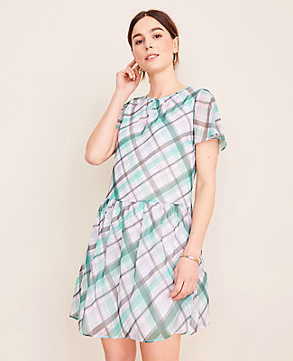 In a palette of spring-ready colors, our plaid shift dress is the perfect check mate for the season. Shirred jewel neck. Short sleeves. Shirred waist seam. Back slit with button closure. Lined body. Ann Taylor Plaid Shift Dress