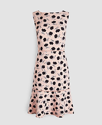 Blooming with fresh-cut florals, our fitted sheath dress takes a twirl with a pretty flounce hem. Boatneck. Sleeveless. Flounce hem. Hidden back zipper with hook-and-eye closure. Lined. Ann Taylor Floral Flounce Hem Sheath Dress