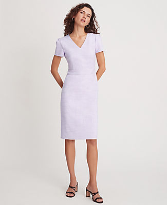 A timeless silhouette for work and beyond, our crosshatch sheath dress gets a lift from feminine puff sleeves. V-neck. Short sleeves with shirred sleeve caps. Inset waistband. Hidden back zipper with hook-and-eye closure. Back vent. Lined. Ann Taylor Crosshatch Puff Sleeve Sheath Dress