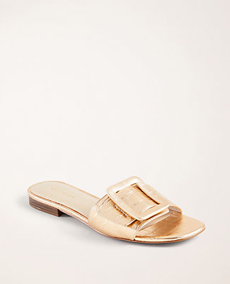 Topped with stylish buckle detail, our embossed leather slide sandals go the extra mile in style. Padded footbed for comfort. 1/2\