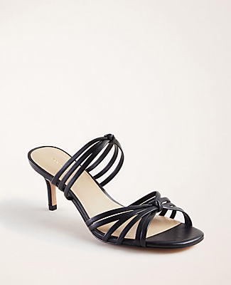 In a well-heeled silhouette, our rich leather sandals elevate any ensemble. Padded footbed for comfort. 2 1/2\
