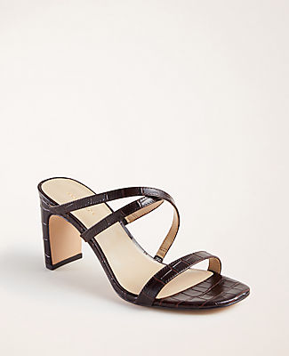 In a well-heeled silhouette, our embossed leather sandals elevate any ensemble. Padded footbed for comfort. 2 1/2\