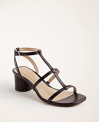 Step into stylish territory with our embossed leather sandals, boosted with a standout block heel. Padded footbed for comfort. 2 1/4\