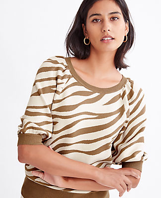 Show your stripes with our zebra print sweater, elevated with of-the-moment puff sleeves. Jewel neck. Raglan elbow sleeves with gathered shoulders. Ribbed neckline, cuffs and hem. Ann Taylor Zebra Print Puff Sleeve Sweater
