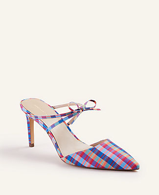 Pump and mule rolled in one, this bow-tied plaid pair keeps your wardrobe in check. Pointy toe. Padded footbed for complete comfort. Covered 3\