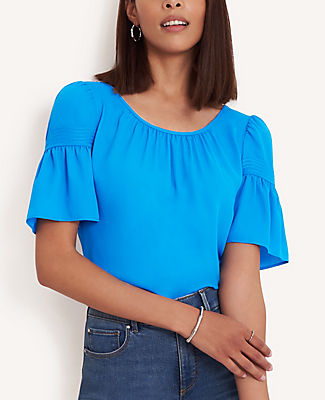 Refined with trapunto stitched flare sleeves, our mixed media tee is modern, easy and remarkably flattering. Shirred boatneck. Short sleeves with trapunto stitched seams and shirred sleeve caps. Woven front and sleeves. Knit back. Ann Taylor Petite Mixed Media Flare Sleeve Tee