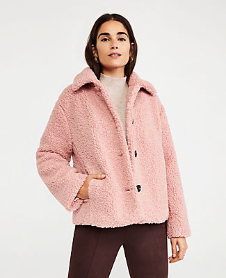 A modern topper to warm up to, this touchably textured coat keeps you cozy throughout the season. Rounded point collar. Long sleeves. Button front. Drop shoulders. Vertical on-seam pockets. Lined. Ann Taylor Short Teddy Coat