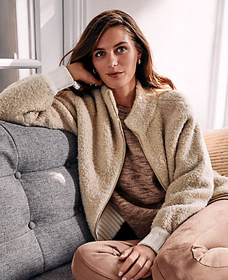 Our boucle zip jacket is set for the season in a cozy textured stitch. Stand collar. Long sleeves. Exposed metal zip front. Drop shoulders. Ribbed cuffs and hem. Ann Taylor Boucle Zip Jacket
