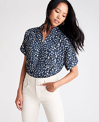 The embodiment of everyday ease, our drop shoulder popover has a front slit you can wear hooked or unhooked - for two looks in one. Stand collar with front slit and hook-and-eye closure. Short dolman sleeves with cuffs. Shirred forward shoulder seams. Side slits. Shirred back yoke. Ann Taylor Spotted Drop Shoulder Popover Top