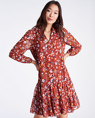 Styled with a tiered flounce hem, our airy floral shift dress is modern romance at its best. V-neck. Long sleeves with shirred sleeve caps and button cuffs. Lined body. Ann Taylor Floral Tiered Flounce Shift Dress