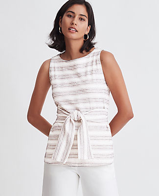 Cinched with wraparound waist ties, this jacquard shell is one of our most flattering (and versatile) silhouettes. Jewel neck. Sleeveless. Self tie belt. Ann Taylor Petite Jacquard Tie Waist Shell Top