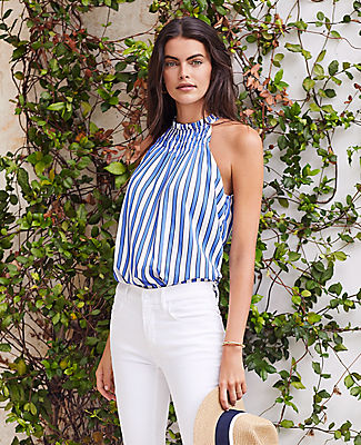 Between the smocked neckline and fluid drape, our striped halter is an irresistibly fresh silhouette. Smocked halter neck. Back slit with button closure. Ann Taylor Stripe Smocked Halter Top