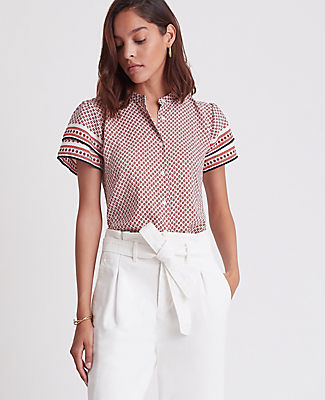Tailored with a sleek nehru collar and breezy flutter sleeves, this button down top is always polished - on or off duty. Nehru collar. Double flutter sleeves with shirred sleeve caps. Button front. Back yoke. Shirttail hem. Ann Taylor Petite Scarf Print Nehru Collar Flutter Sleeve Top