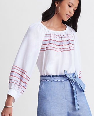 Artful embroidery weaves a beachy thread into this airy cotton top, finished with wide cuff balloon sleeves. Elasticized boatneck. Long raglan sleeves with button cuffs. Shirttail hem. Ann Taylor Petite Embroidered Balloon Sleeve Top