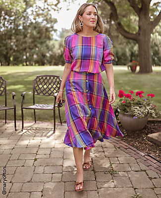 One of our favorite warm weather patterns, our vibrant madras top is smocked at the hem for waist-cinching silhouette. Boatneck. Short sleeves with shirred sleeve caps. Smocked hem. Ann Taylor Petite Madras Plaid Smocked Hem Top