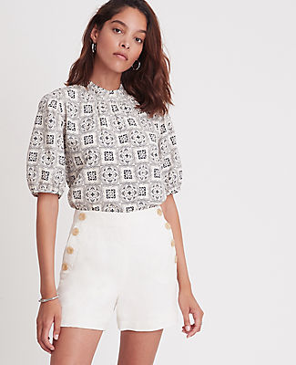 Topped with a sleek mock neck and pretty puff sleeves, this woven top is always polished and pulled together. Mock neck with shirring beneath. Short sleeves with shirred sleeve caps. Back slit with button closure. Lined body. Ann Taylor Petite Tiled Mock Neck Top