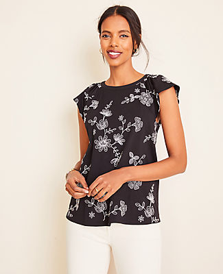 Pretty pleats pair with airy flutter sleeves for a romantic look that makes our hearts skip a beat. Jewel neck. Raglan flutter sleeves. Ann Taylor Floral Embroidered Pleated Flutter Sleeve Top