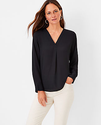 A clever pleated front adds extra ease and fluidity to this knit and woven essential. V-neck with pleat beneath. Long sleeves with button cuffs. Shirttail hem. Woven front and sleeves. Knit back. Ann Taylor Mixed Media Pleat Front Top