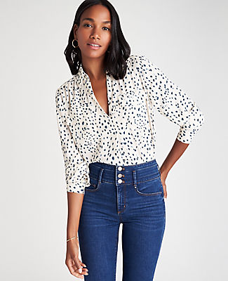We\\\'ve updated our camp shirt with a covered button front and extra shirring, for a fluid and streamlined silhouette that works anywhere. Point collar. Long sleeves with button cuffs. Hidden button front placket with pleat beneath. Front flap patch pockets. Shirred forward shoulder seams and back yoke. Shirttail hem. Ann Taylor Spotted Camp Shirt