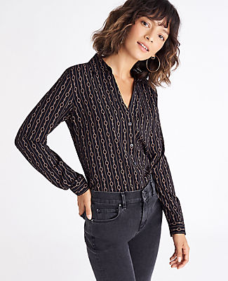 With a slim fit and a bit of drape, count on this one every time you go to your closet. Point collar. Long sleeves with button cuffs. Button front placket. Back yoke. Shirttail hem. Ann Taylor Linked Essential Shirt