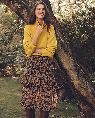 In a flattering midi length, this floral chiffon skirt is flounced with curved tiers of feminine ruffles. Hidden back zipper with hook-and-eye closure. Lined. Ann Taylor Petite Floral Flounce Midi Skirt