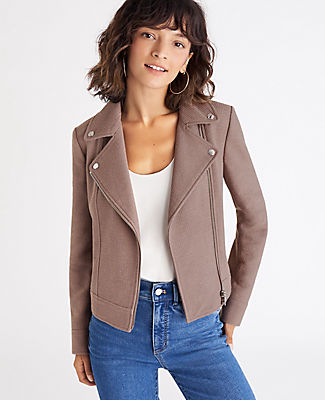 Kick start the season with our refined tweed moto, destined to rev up your on and off-duty wardrobe. Notched lapel with snaps. Long sleeves with exposed metallic zip cuffs. Exposed metallic zip front. Exposed metallic zip pockets. Back yoke. Lined. Ann Taylor Tweed Moto Jacket