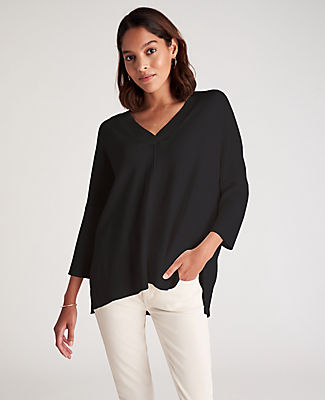 Tailored with finely ribbed sleeves, our versatile V-neck sweater is cut with side slits for extra ease. V-neck. Long sleeves. Drop shoulders. Side slits. Ribbed hem. Ann Taylor Easy V-Neck Sweater