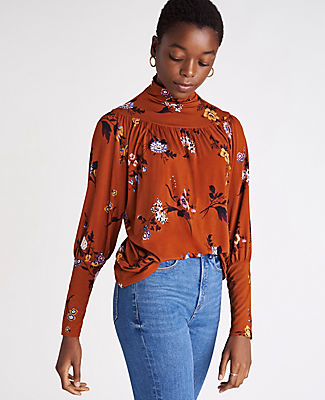 We\\\'ve elevated this turtleneck top with soft shirring and wide cuffs - perfect for days (and nights) when you\\\'re feeling romantic. Turtleneck. Long sleeves. Shirred front and back yoke. Ann Taylor Petite Floral Shirred Turtleneck Top