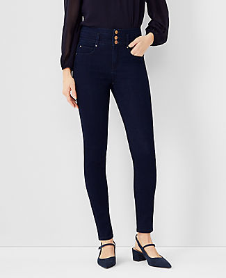 Designed with new pockets that smooth, flatter and hold your shape. Here\\\'s the skinny: your favorite jeans just got a major upgrade. Performance stretch denim sculpts, shapes and supports all day long. Front zip with button closure. Belt loops. Classic five-pocket styling. Ann Taylor Petite Sculpting Pocket High Rise Skinny Jeans in Dark Rinse Wash